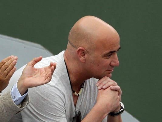 Serbia's Novak Djokovic's coach Andre Agassi, of the United States, watches Argentina's Diego Schwartzman playing Djokovic during their third round match of the French Open tennis tournament at the Roland Garros stadium, Friday, June 2, 2017 in Paris. (AP Photo/Petr David Josek)