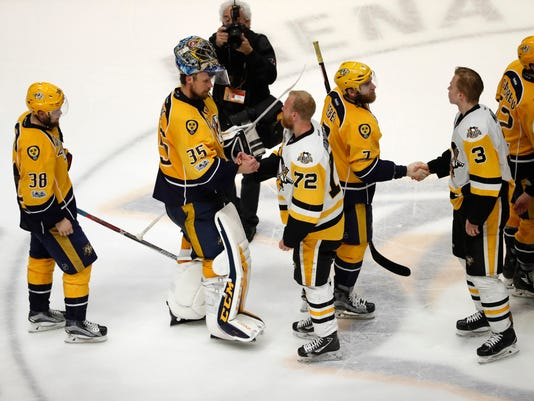Players shakes hands following Game 6 of the NHL hockey Stanley Cup Final between the Pittsburgh Penguins and the Nashville Predators, Sunday, June 11, 2017, in Nashville, Tenn. (AP Photo/Jeff Roberson)