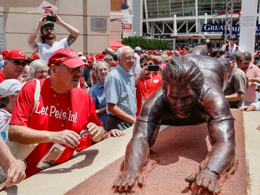 Fans gather around the newly dedicated statue of former Cincinnati Reds player Pete Rose outside Great American Ballpark prior to a baseball game between the Cincinnati Reds and the Los Angeles Dodgers, Saturday, June 17, 2017, in Cincinnati. (AP Photo/John Minchillo)