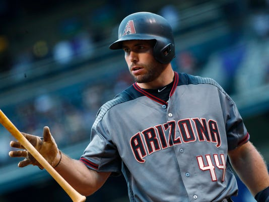 Arizona Diamondbacks' Paul Goldschmidt reacts after swinging and missing a pitch from Colorado Rockies starting pitcher Jeff Hoffman in the first inning of a baseball game Wednesday, June 21, 2017, in Denver. (AP Photo/David Zalubowski)