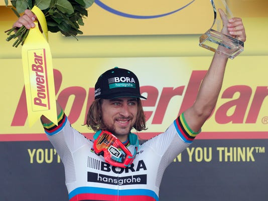 Stage winner Peter Sagan of Slovakia celebrates on the podium after the third stage of the Tour de France cycling race over 212.5 kilometers (132 miles) with start in Verviers, Belgium and finish in Longwy, France, Monday, July 3, 2017. (AP Photo/Christophe Ena)