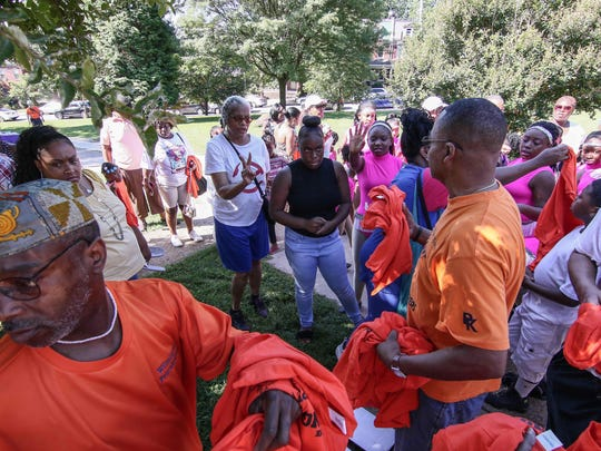 Associate Director Terry Walls (RIGHT) distributes orange t-shirts prior to the start of the fifth annual Wilmington Peace keepers children's peace rally Saturday, July 08, 2017 at Tilton Park in Wilmington.