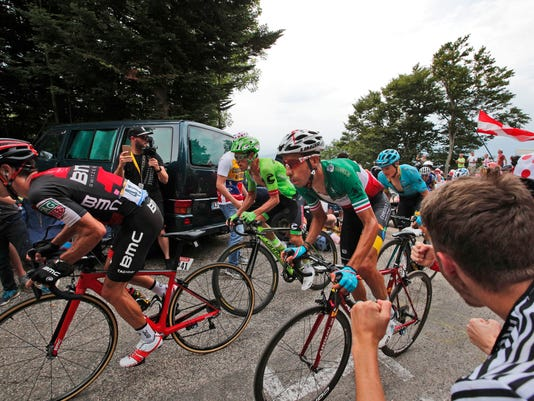 Australia's Richie Porte, stage winner Colombia's Rigoberto Uran, Italy's Fabio Aru, and Denmark's Jakob Fuglsang, from left, climb during the ninth stage of the Tour de France cycling race over 181.5 kilometers (112.8 miles) with start in Nantua and finish in Chambery, France, Sunday, July 9, 2017. (AP Photo/Christophe Ena)