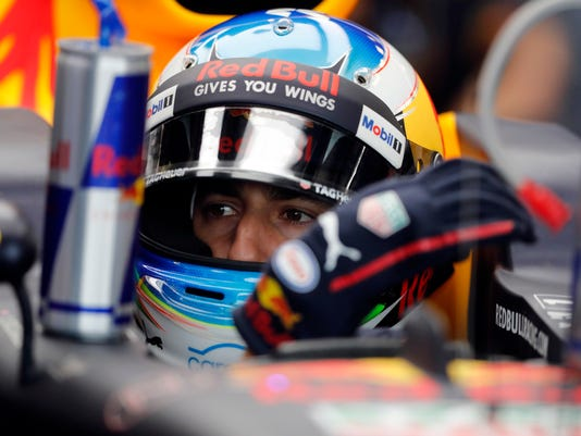 Red Bull driver Daniel Ricciardo of Australia sits in his car cockpit during the third free practice session for the British Formula One Grand Prix at the Silverstone racetrack in Silverstone, England, Saturday, July 15, 2017. The British Formula One Grand Prix will be held on Sunday, July 16. (AP Photo/Frank Augstein)