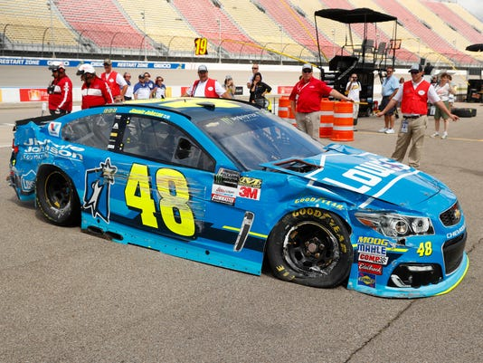 Jimmie Johnson drives his car to the garage after hitting the wall during practice for the NASCAR Cup Series auto race in Brooklyn, Mich., Saturday, Aug. 12, 2017. (AP Photo/Paul Sancya)