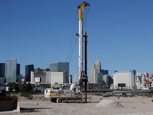 A drilling rig sits on the Oakland Raiders' proposed stadium site Thursday, Aug. 17, 2017, in Las Vegas. The public entity that oversees the proposed Raiders stadium in Las Vegas on Thursday is expected to address the multi-million dollar bank loan the team is getting to finance part of the project. (AP Photo/John Locher)