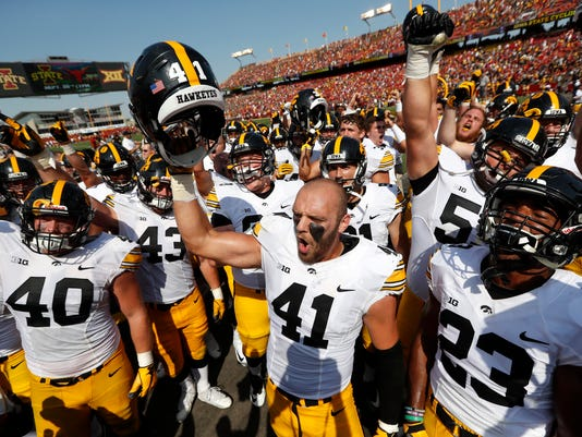 Iowa linebacker Bo Bower (41) celebrates with teammates after an NCAA college football game against Iowa State, Saturday, Sept. 9, 2017, in Ames, Iowa. Iowa won 44-41 in overtime. (AP Photo/Charlie Neibergall)