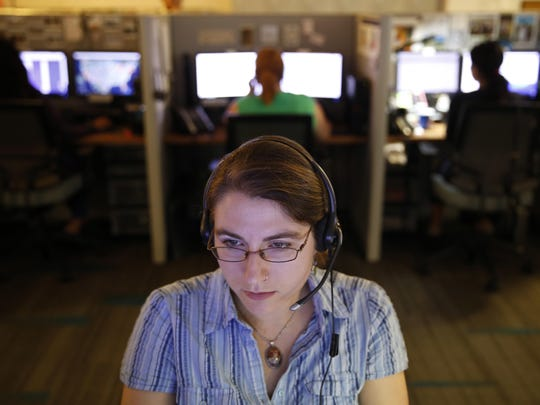 An advocate at the National Human Trafficking Hotline call center listens Tuesday in Washington. The center is a conduit for people to report suspected trafficking and can immediately connect victims with the help they need.