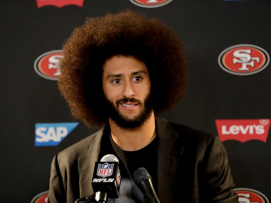 This Dec. 24, 2016 photo shows San Francisco 49ers quarterback Colin Kaepernick talking during a news conference after an NFL football game against the Los Angeles Rams. Kaepernick filed a grievance against the NFL on Sunday, Oct. 15, 2017 alleging that he remains unsigned as a result of collusion by owners following his protests during the national anthem. (AP Photo/Rick Scuteri)