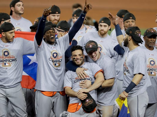 The Houston Astros celebrate after their win against the Los Angeles Dodgers in Game 7 of baseball's World Series Wednesday, Nov. 1, 2017, in Los Angeles. The Astros won 5-1 to win the series 4-3. (AP Photo/Alex Gallardo)