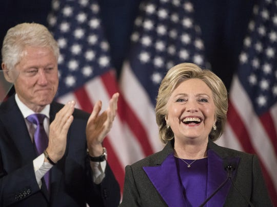 Former President Bill Clinton applauds as Hillary Clinton speaks in New York Nov. 9, when she conceded her defeat to Republican Donald Trump in the presidential election.