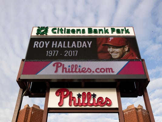 A sign outside Citizens Bank Park displays a message of remembrance of former Phillies pitcher Roy Halladay in Philadelphia, Wednesday, Nov. 8, 2017. Halladay, a two-time Cy Young Award winner who pitched a perfect game and a playoff no-hitter for the Phillies, died Tuesday when his private plane crashed into the Gulf of Mexico. He was 40. (AP Photo/Matt Rourke)