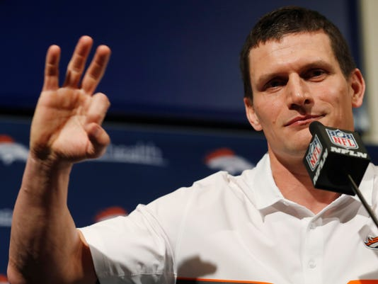 """FILE - In this Feb. 7, 2017, file photo, Denver Broncos special teams coordinator Brock Olivo responds to question during a news conference at the team's headquarters in Englewood, Colo.  Denver's rookie special teams coach willingly accepts blame for any and all blunders made by his blocking or coverage units and especially any mistakes made by kicker Brandon McManus, punter Riley Dixon and rookie returner Isaiah McKenzie.  """"The way I see it is the product that we put on the field is a reflection of me and a reflection of my work,"""" Olivo said. (AP Photo/David Zalubowski, File)"""