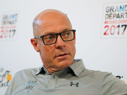 FILE - In this Wednesday, June 28, 2017 file photo, Sky team manager Sir Dave Brailsford attends a press conference ahead of Saturday's start of the Tour de France cycling race in Duesseldorf, Germany. Britain's anti-doping agency says Wednesday Nov. 15, 2017, it won't bring any charges over the medical package dispatched to star Team Sky rider Bradley Wiggins after the investigation was hampered by the lack of accurate records held by cycling authorities. (AP Photo/Christophe Ena, File)