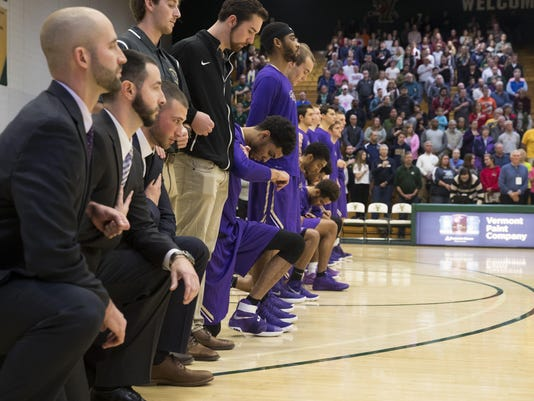 St. Michael's men's basketball players kneel at the anthem in exhibition game at UVM