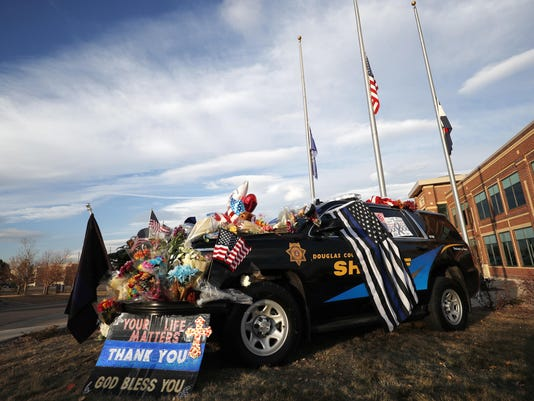 Douglas County,Colo.,Sheriffs Department vehicle covered with tributes to fallen deputy