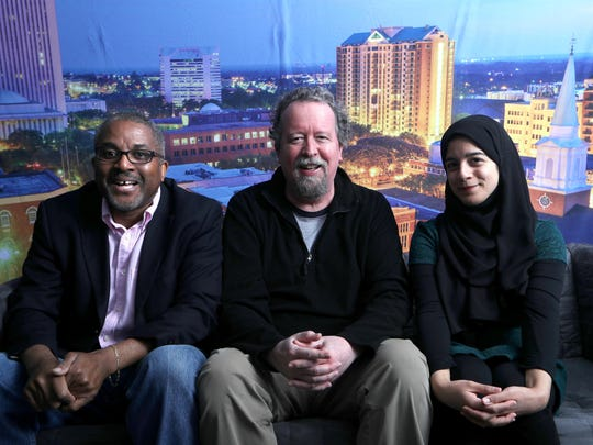 Tallahassee Democrat writers-columnists Andrew Skerritt, left, Mark Hinson, center, and Nada Hassanein were the tellers at the Democrat's first storytellers night.