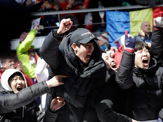 Fans cheer for Yun Sungbin of South Korea as his wins the gold medal during the men's skeleton final at the 2018 Winter Olympics in Pyeongchang, South Korea, Friday, Feb. 16, 2018. (AP Photo/Wong Maye-E)