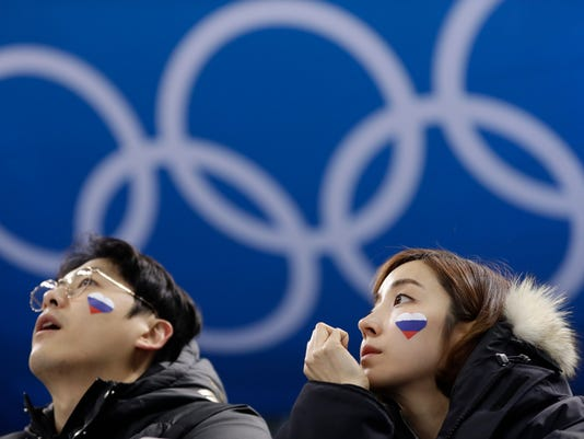 Supporters of Russian athletes wait before the preliminary round of the men's hockey game between the team from Russia and the United States at the 2018 Winter Olympics in Gangneung, South Korea, Saturday, Feb. 17, 2018. (AP Photo/Matt Slocum)