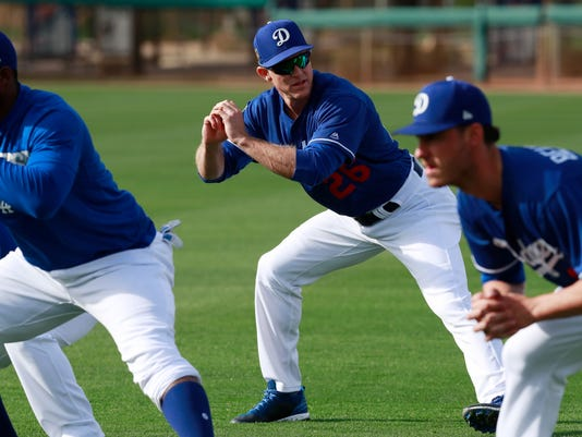 Los Angeles Dodgers second baseman Chase Utley stretches with teammates at the team's spring training baseball facility Monday, Feb. 19, 2018, in Glendale, Ariz. (AP Photo/Carlos Osorio)