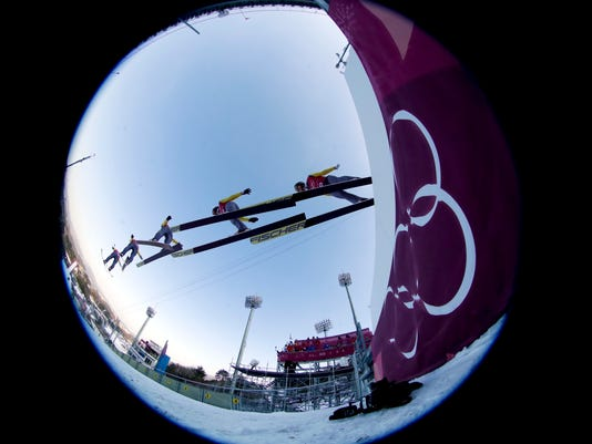 In this multiple exposure picture made through a fisheye lens shows Hannu Manninen, of Finland, jumping during training for the men's nordic combined competition at the 2018 Winter Olympics in Pyeongchang, South Korea, Tuesday, Feb. 13, 2018. (AP Photo/Dmitri Lovetsky)