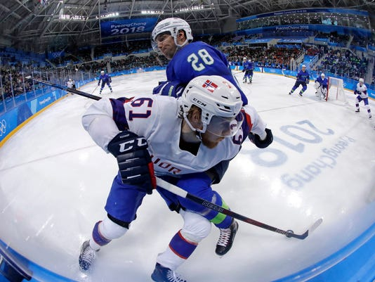 Ales Kranjc (28), of Slovenia, checks Alexander Reichenberg (61), of Norway, during the third period of the qualification round of the men's hockey game at the 2018 Winter Olympics in Gangneung, South Korea, Tuesday, Feb. 20, 2018. (AP Photo/Julio Cortez)