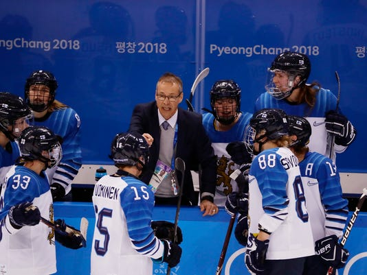 head coach Pasi Mustonen talks to his team during the third period of the women's bronze medal hockey game against the team from Russia at the 2018 Winter Olympics in Gangneung, South Korea, Wednesday, Feb. 21, 2018. Finland won 3-2. (AP Photo/Frank Franklin II)