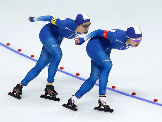 In this Monday Monday, Feb. 19, 2018, image team South Korea with Kim Bo-reum, front, Park Ji Woo, second, and Noh Seon-yeong, trailing behind and not in picture, competes in the women's team pursuit speed skating race at the 2018 Winter Olympics in Gangneung, South Korea. Thousands of South Koreans are calling for two speedskaters Kim and Park to be expelled from the Olympics after they left their slower teammate Noh behind in a race defined by teamwork and walked away as she quietly sobbed at the stadium in one of the most bizarre moments of this year's Winter Games. (AP Photo/John Locher)