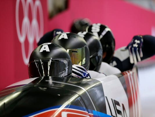 Driver Justin Olsen, Christopher Fogt, Carlo Valdes and Nathan Weber of the United States start their third heat during the four-man bobsled competition final at the 2018 Winter Olympics in Pyeongchang, South Korea, Sunday, Feb. 25, 2018. (AP Photo/Wong Maye-E)