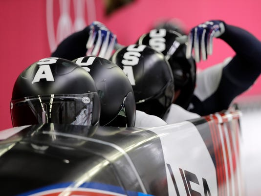 Driver Justin Olsen, Christopher Fogt, Carlo Valdes and Nathan Weber of the United States start their heat on the first day of four-man bobsled competition at the 2018 Winter Olympics in Pyeongchang, South Korea, Saturday, Feb. 24, 2018. (AP Photo/Wong Maye-E)