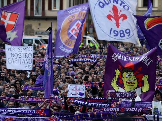 People wait outside the church during the funeral ceremony of Italian player Davide Astori in Florence, Italy, Thursday, March 8, 2018. The 31-year-old Astori was found dead in his hotel room on Sunday after a suspected cardiac arrest before his team was set to play an Italian league match at Udinese. (AP Photo/Alessandra Tarantino)