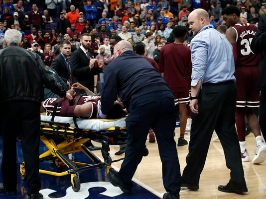 Mississippi State's Nick Weatherspoon is taken off on a stretcher after he was injured in the second half of an NCAA college basketball game against Tennessee in the quarterfinals of the Southeastern Conference tournament Friday, March 9, 2018, in St. Louis. (AP Photo/Jeff Roberson)
