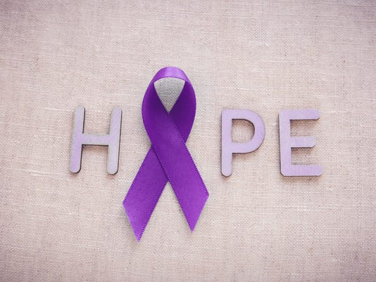 Purple ribbons with HOPE word Alzheimers disease Pancreatic c