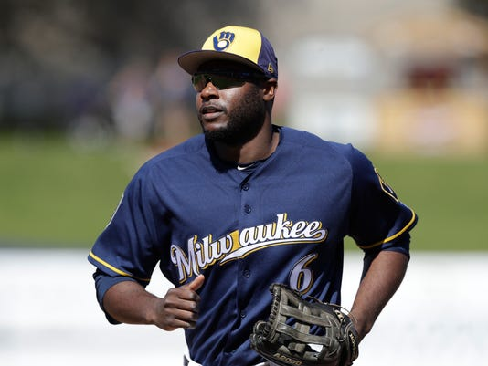 FILE - In this Feb. 26, 2018, file photo, Milwaukee Brewers outfielder Lorenzo Cain runs to the dugout during a spring training baseball game against the Cleveland Indians in Maryvale, Ariz. Outfielders Lorenzo Cain and Christian Yelich are just as capable of changing games with their gloves. The two big offseason acquisitions make their Brewers debut when Milwaukee visits the San Diego Padres for their season opener on March 29. (AP Photo/Carlos Osorio, File)