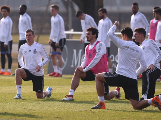from left: german national soccer players Toni Kroos, Mats Hummels, Sami Khedira and Mario Gomez  warm up during a practice session, in Berlin, Sunday, March 25, 2018. Germany will face Brazil in an international friendly soccer match on Tuesday.  (Christian Charisius/dpa via AP)