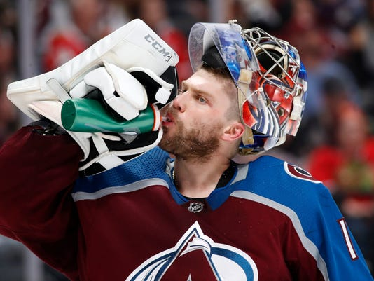 Colorado Avalanche goaltender Semyon Varlamov takes a drink during a time out against the Chicago Blackhawks in the second period of an NHL hockey game Friday, March 30, 2018, in Denver. (AP Photo/David Zalubowski)
