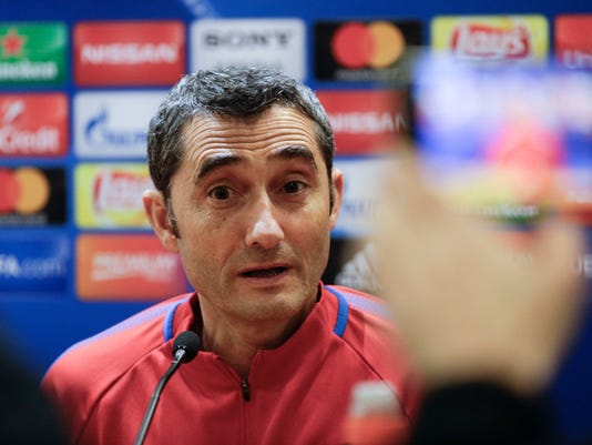 Barcelona coach Ernesto Valverde talks to reporters during a press conference he held at Rome's Olympic Stadium, Monday, April 9, 2018, on the eve of the Champions League quarter final second leg soccer match against Roma. (AP Photo/Gregorio Borgia)
