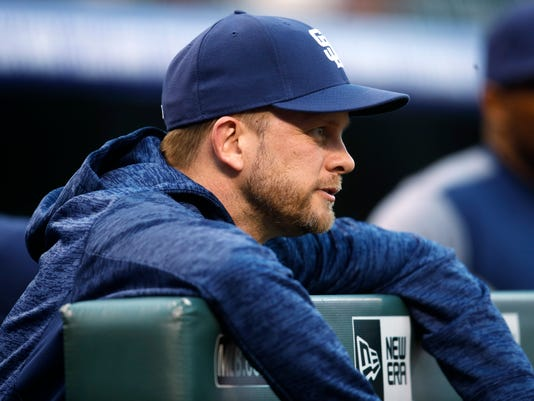 San Diego Padres manager Andy Green hangs over the dugout rail as he looks on against the Colorado Rockies in the first inning of a baseball game Tuesday, April 10, 2018, in Denver.(AP Photo/David Zalubowski)