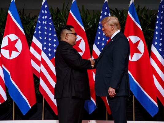 IMG_AP_TRUMP_KIM_SUMMIT__1_1_7NM6BOCB.jpg_20180614.jpg