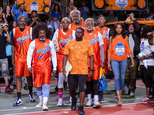 "Chris Webber, left, as Preacher, Nate Robinson as Boots, Lisa Leslie as Betty Lou, Shaquille O'Neal as Big Fella, Lil Rel Howery as Dax, Kyrie Irving as Uncle Drew, Reggie Miller as Lights and Erica Ash as Maya in ""Uncle Drew."""