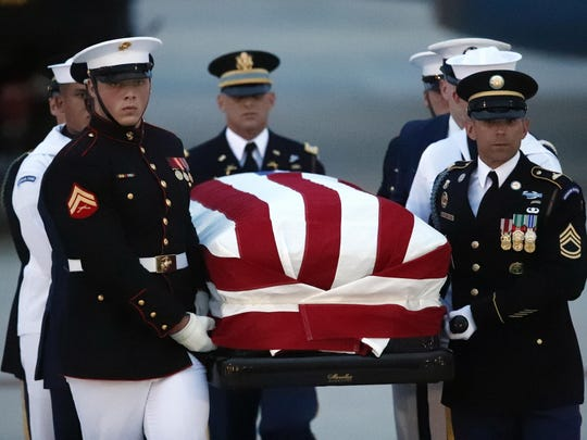 The flag-draped casket of Sen. John McCain, R-Ariz., is carried by an Armed Forces body bearer team to a hearse, Aug. 30, 2018, at Andrews Air Force Base, Md.
