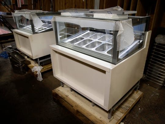 "Shown is a gelato case at the Howard McCray's commercial refrigeration manufacturing facility in Philadelphia. The experience Christopher Scott, president of Howard McCray, has had suggests that the impact of the tariffs is still playing out. Though has absorbed the higher costs for now, he hopes to eventually pass some on to his customers. First, though, he wants to see how his larger competitors handle the higher costs. ""Little Howard McCray can't go out and raise prices 10 percent and lose all the market share that we've worked so hard to gain,"" Scott said."