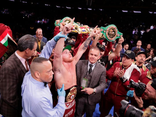 Mexico's Canelo Alvarez celebrates after a WBA super middleweight championship boxing match against England's Rocky Fielding Sunday, Dec. 16, 2018, in New York. Alvarez stopped Fielding in the third round. (AP Photo/Frank Franklin II)