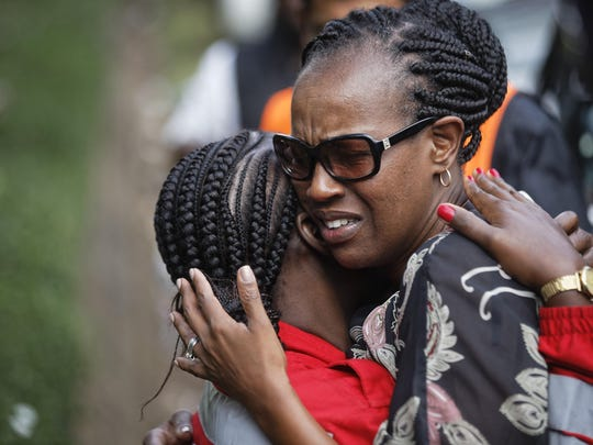 Unidentified women console each other at the scene of a violent attack early Jan. 16, 2019, in Nairobi, Kenya. Extremists stormed a luxury hotel in Kenya's capital on Tuesday, setting off thunderous explosions and gunning down people at cafe tables in an attack claimed by Africa's deadliest Islamic militant group.