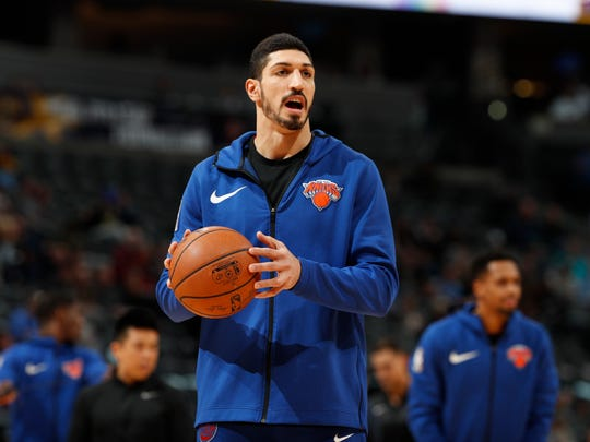 Enes Kanter's role has been reduced as the New York Knicks focus on developing their young players.