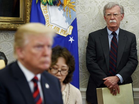 President Donald Trump said Friday he would invoke executive privilege to try to block his former national security adviser from testifying in a Senate impeachment trial.