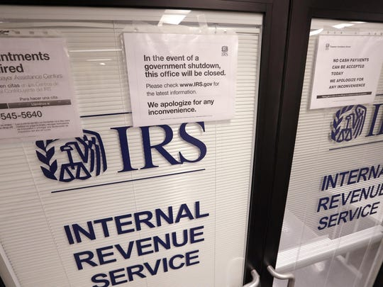Fewer than half of 26,000 furloughed IRS employees who have been recalled to work during the government shutdown to handle tax returns and taxpayers' questions have returned to their jobs as of Tuesday, congressional and government aides say.