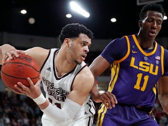 Mississippi State guard Quinndary Weatherspoon (11) protects the ball from LSU forward Kavell Bigby-Williams (11) during the second half of an NCAA college basketball game in Starkville, Miss., Wednesday, Feb. 6, 2019. LSU won in overtime, 92-88. (AP Photo/Rogelio V. Solis)