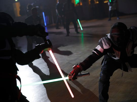 """""""We wanted it to be safe, we wanted it to be umpired and, most of all, we wanted it to produce something visual that looks like the movies, because that is what people expect,"""" said Michel Ortiz, the lightsaber tournament director."""