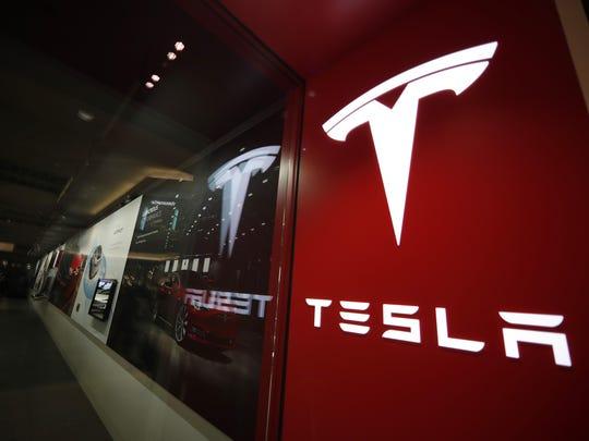 Tesla store,tesla logo